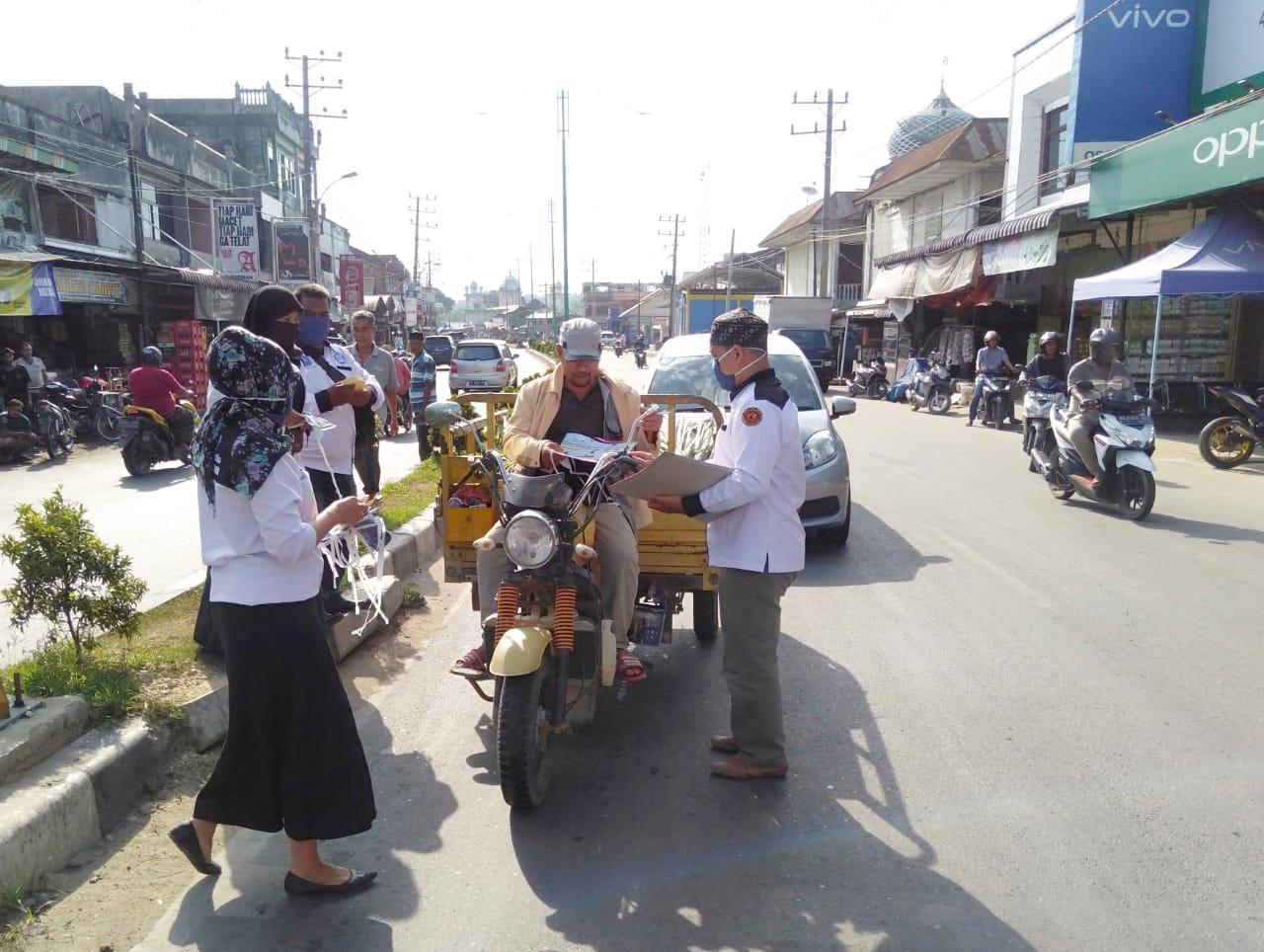 LAN Aceh Timur Bagikan Masker Kemasyarakat Pengemudi Jalan