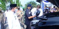 Bupati H Budi Utomo Melakukan Apel Kendaraan Dinas Roda Empat Di Pakiran Stadion Sukung Kotabumi